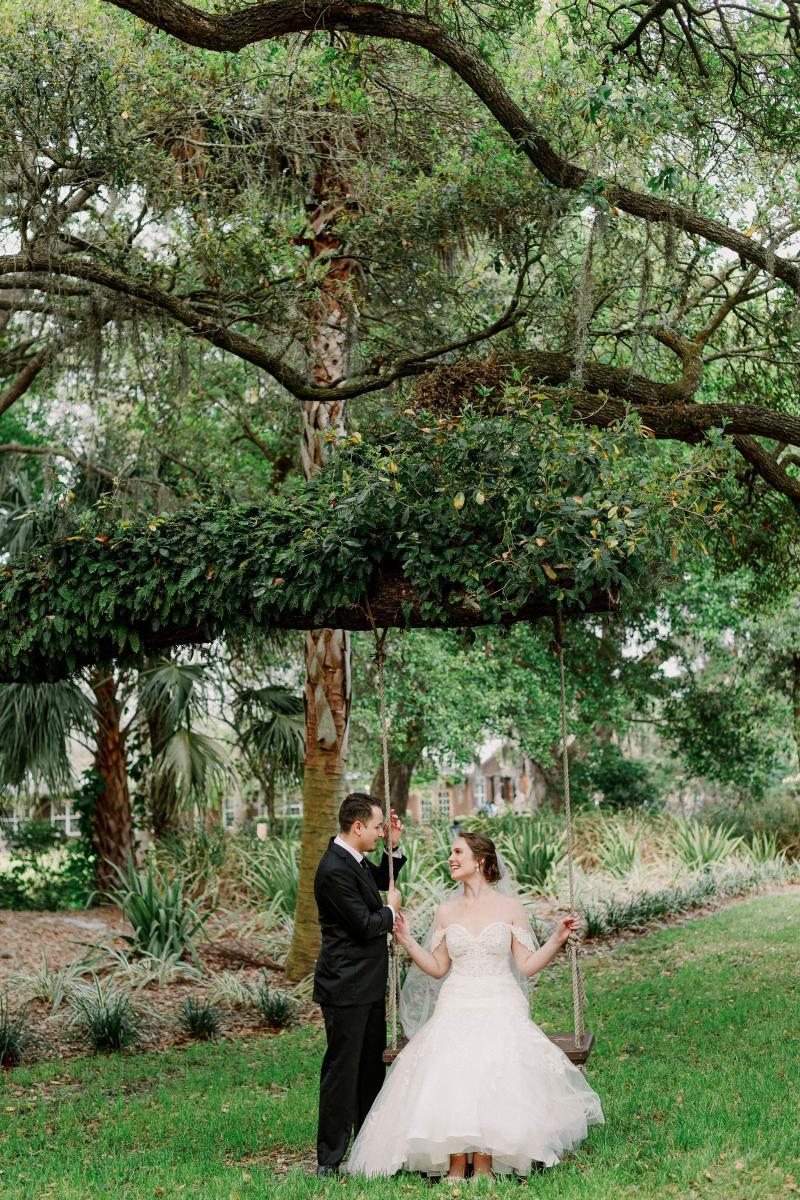 Sweetheart photos on the wedding swing
