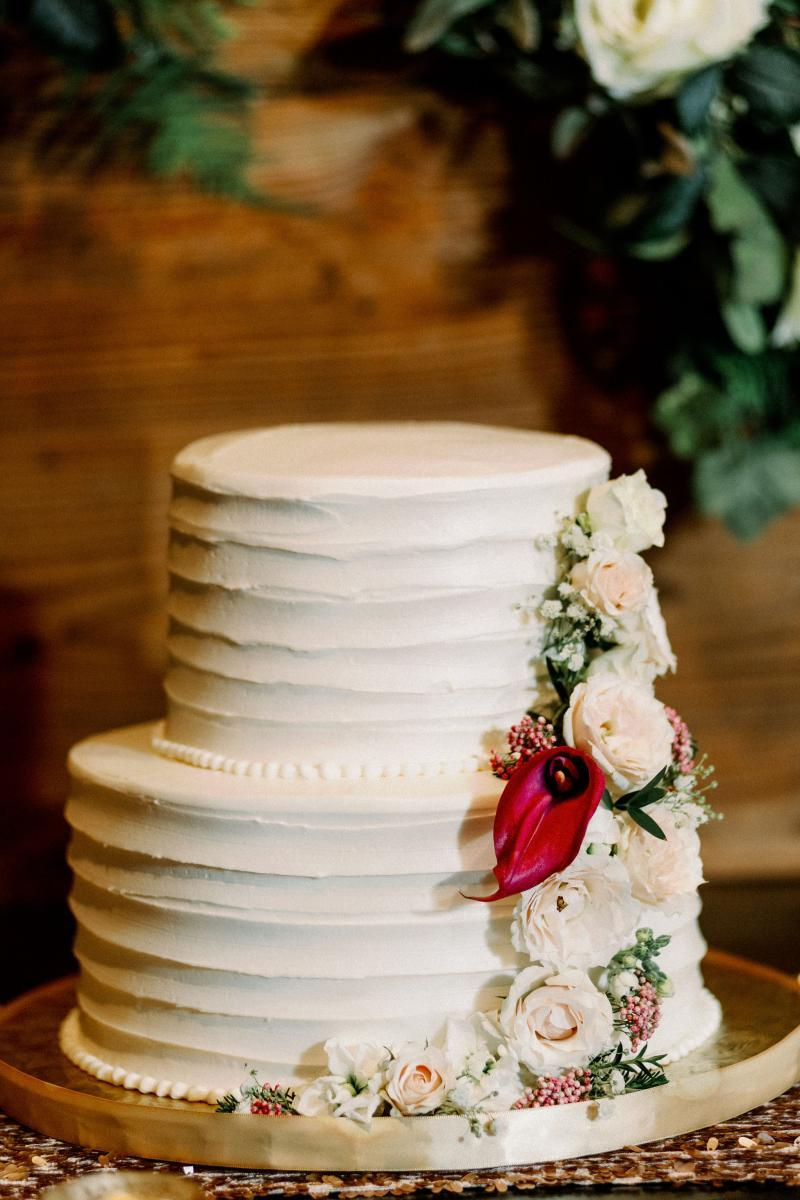 Elegant two tier wedding cake with cascading flowers