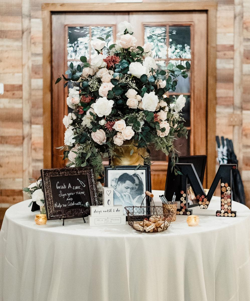 Welcome table with a wine cork guest book
