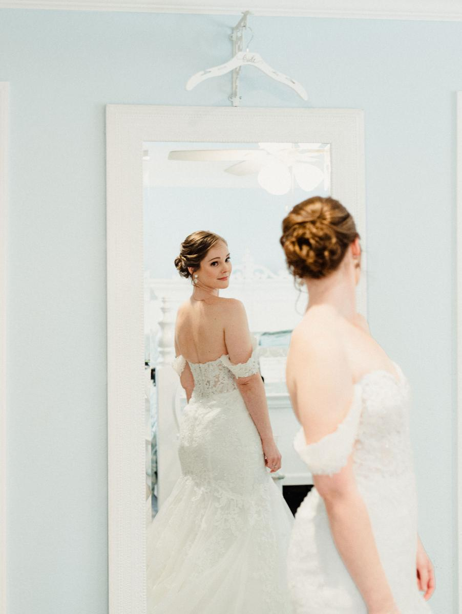 Ashley looked gorgeous in her fit and flair wedding dress by Stella York