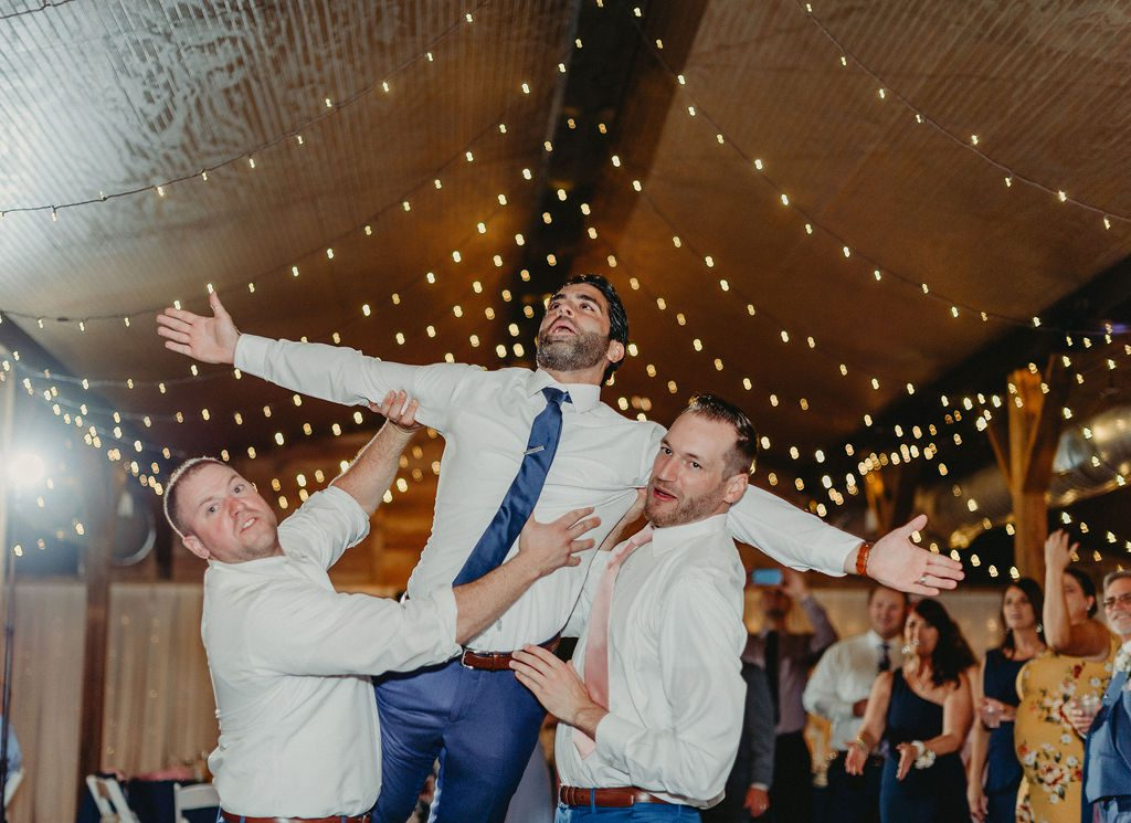 Anthony and his groomsmen having fun dancing the night away