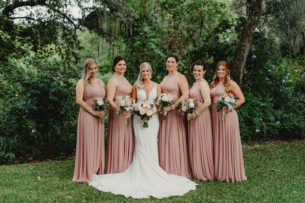Brandy's bridesmaids are dressed in long mauve bridesmaid dresses