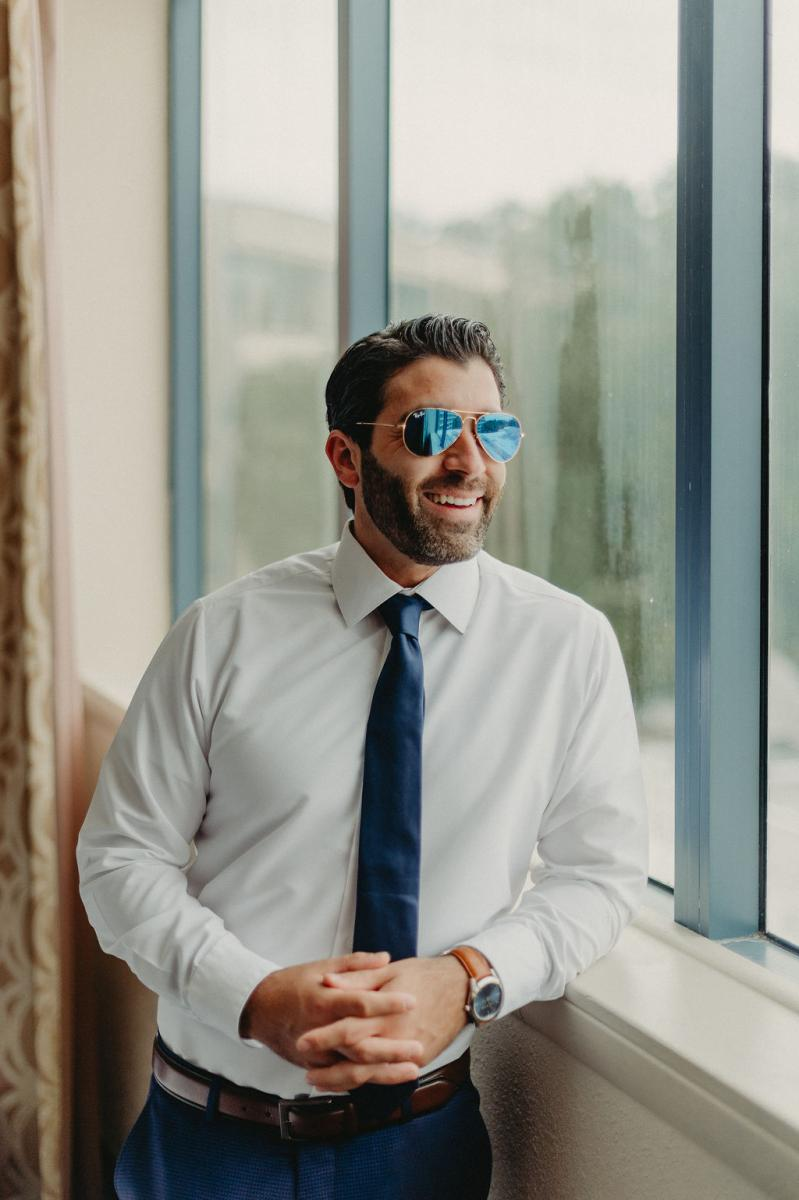 Anthony rocking a cool pair of sunglasses as he is getting ready for his wedding day