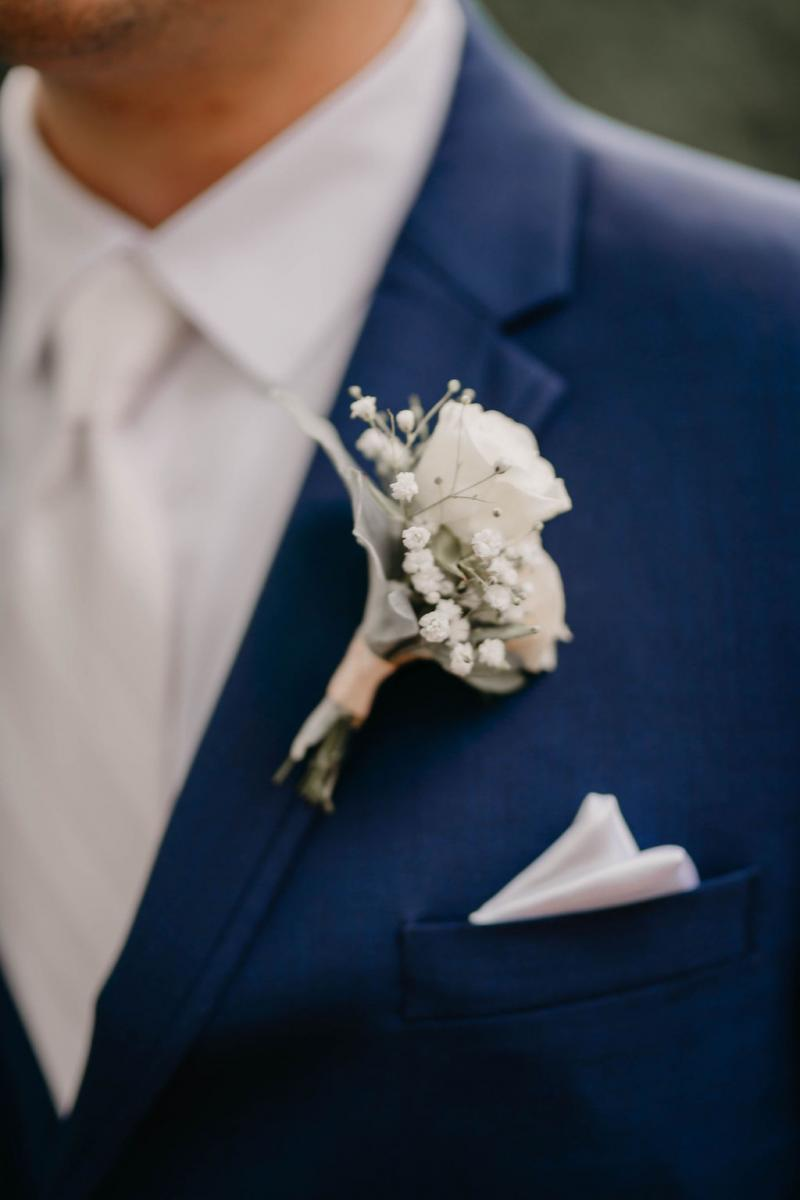 Romantic white and green boutonniere