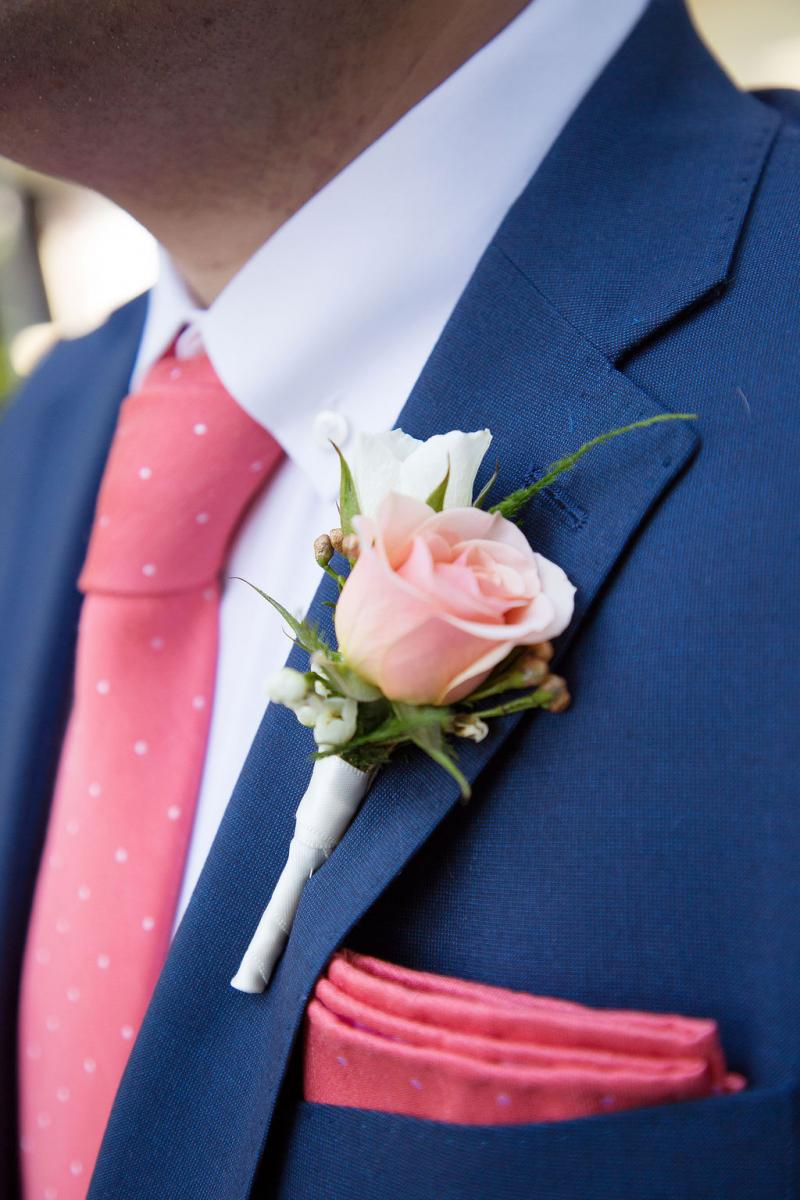Stephen's pretty in pink boutonniere by Alta Fleura