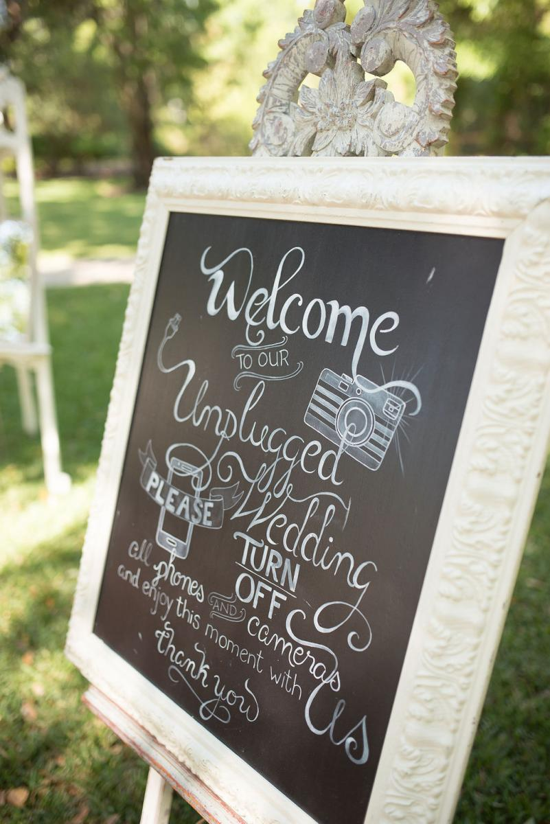 Unplugged wedding ceremony sign on chalkboard