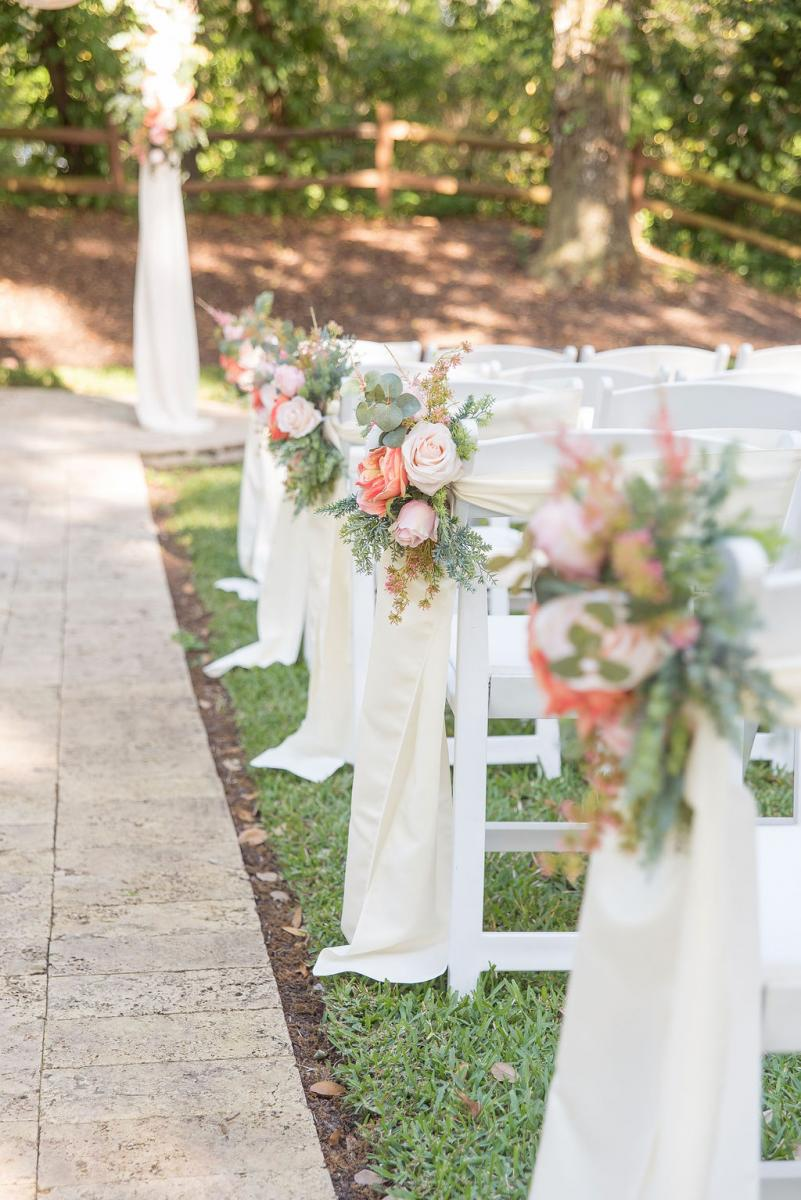 Pretty in pink wedding ceremony aisle decor