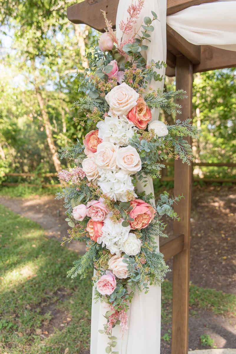 Pretty in pink wedding ceremony arch decor