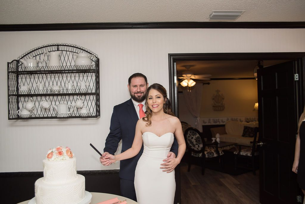 Kathleen and Steven cutting their wedding cake