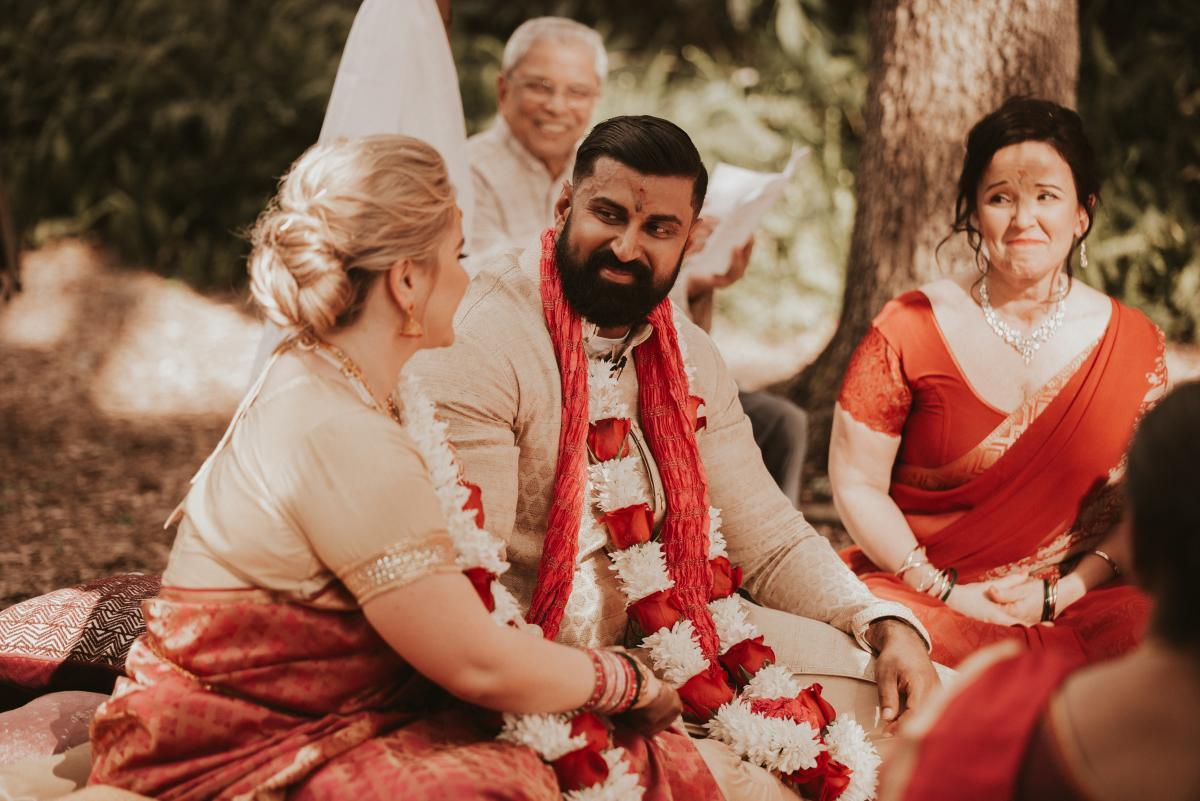 Kiran looking at Sadie during the ceremony