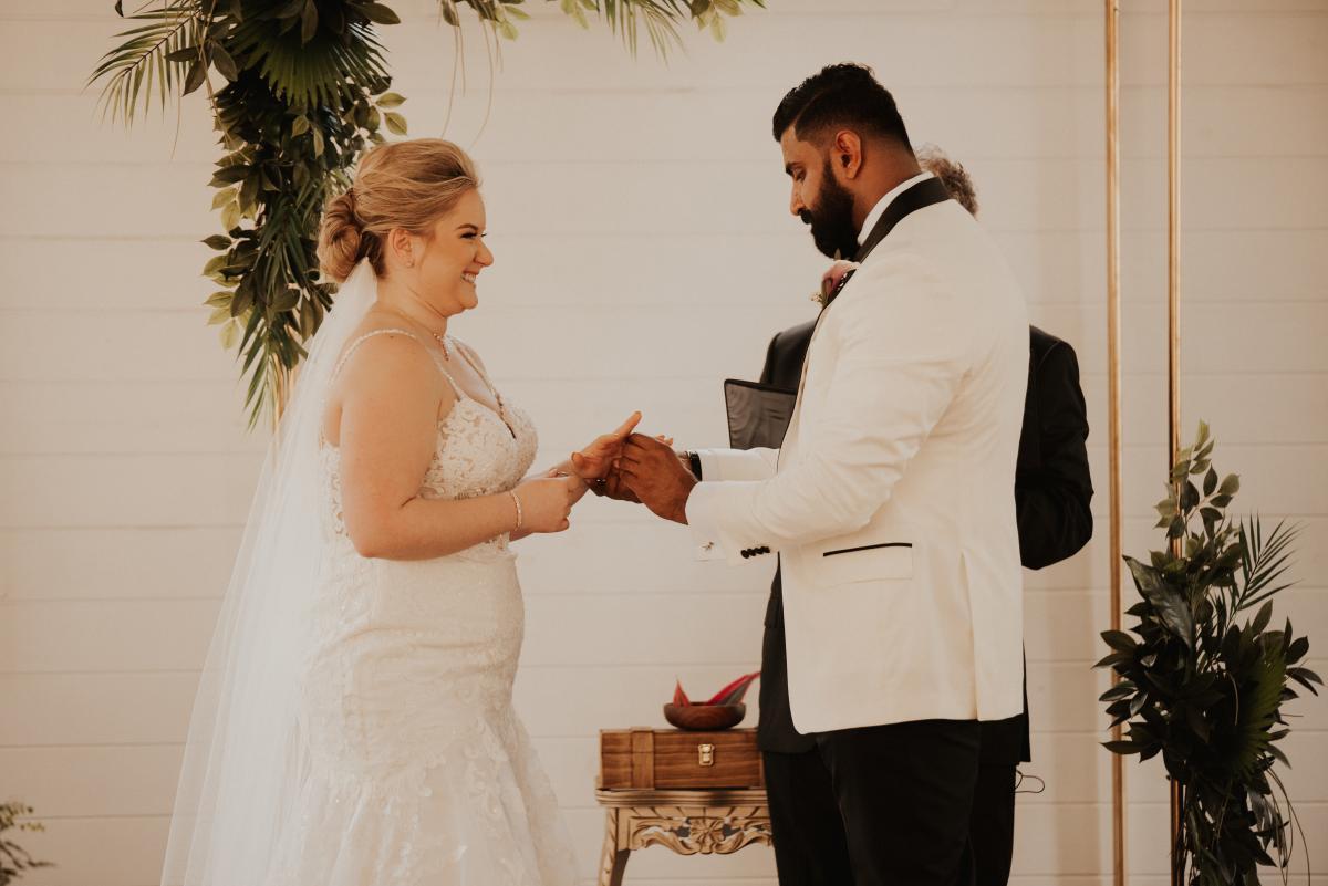 Sadie and Kiran exchanging wedding rings