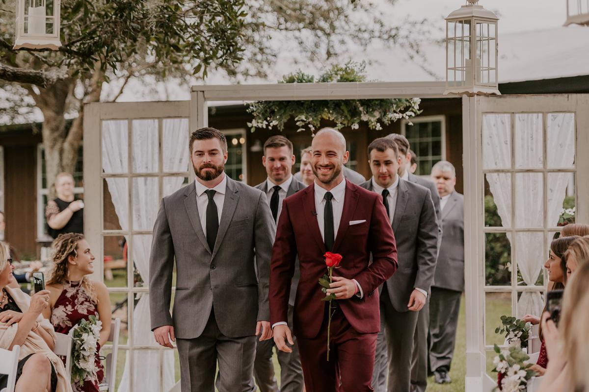 Julian and his groomsmen walking down the aisle