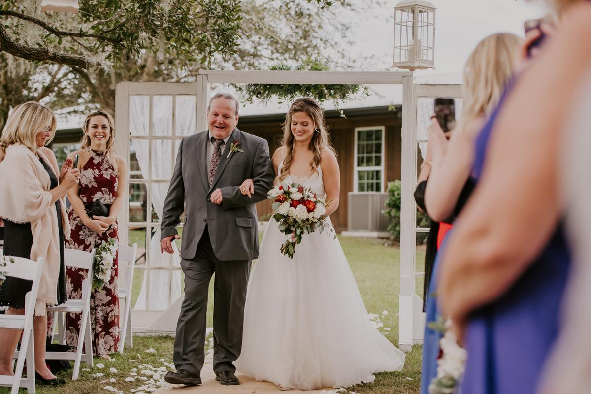 Kirstin walking down the aisle with her dad