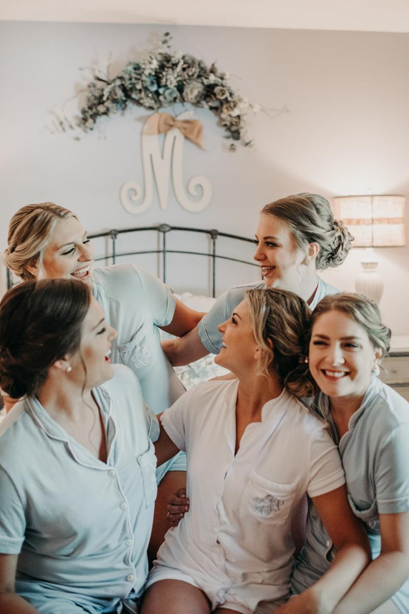 Linea and her bridesmaids in their pajamas after hair and makeup