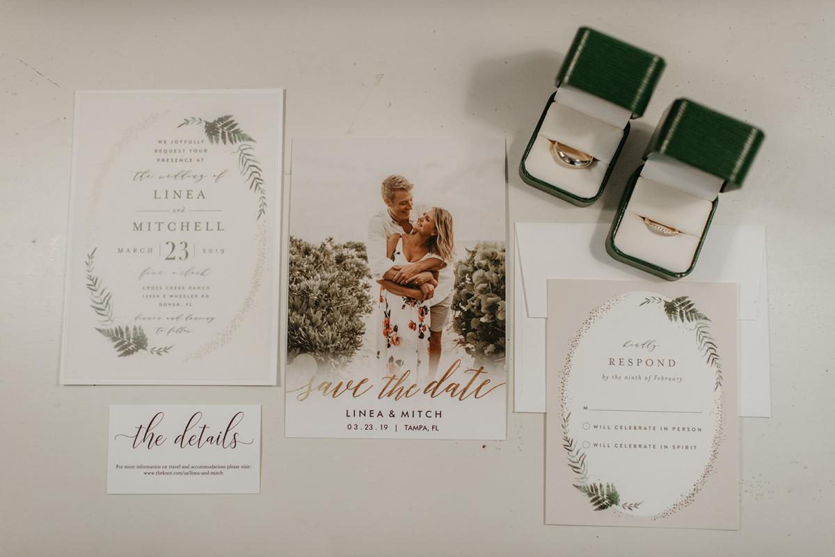 Mitch and Linea's wedding invitations and rings