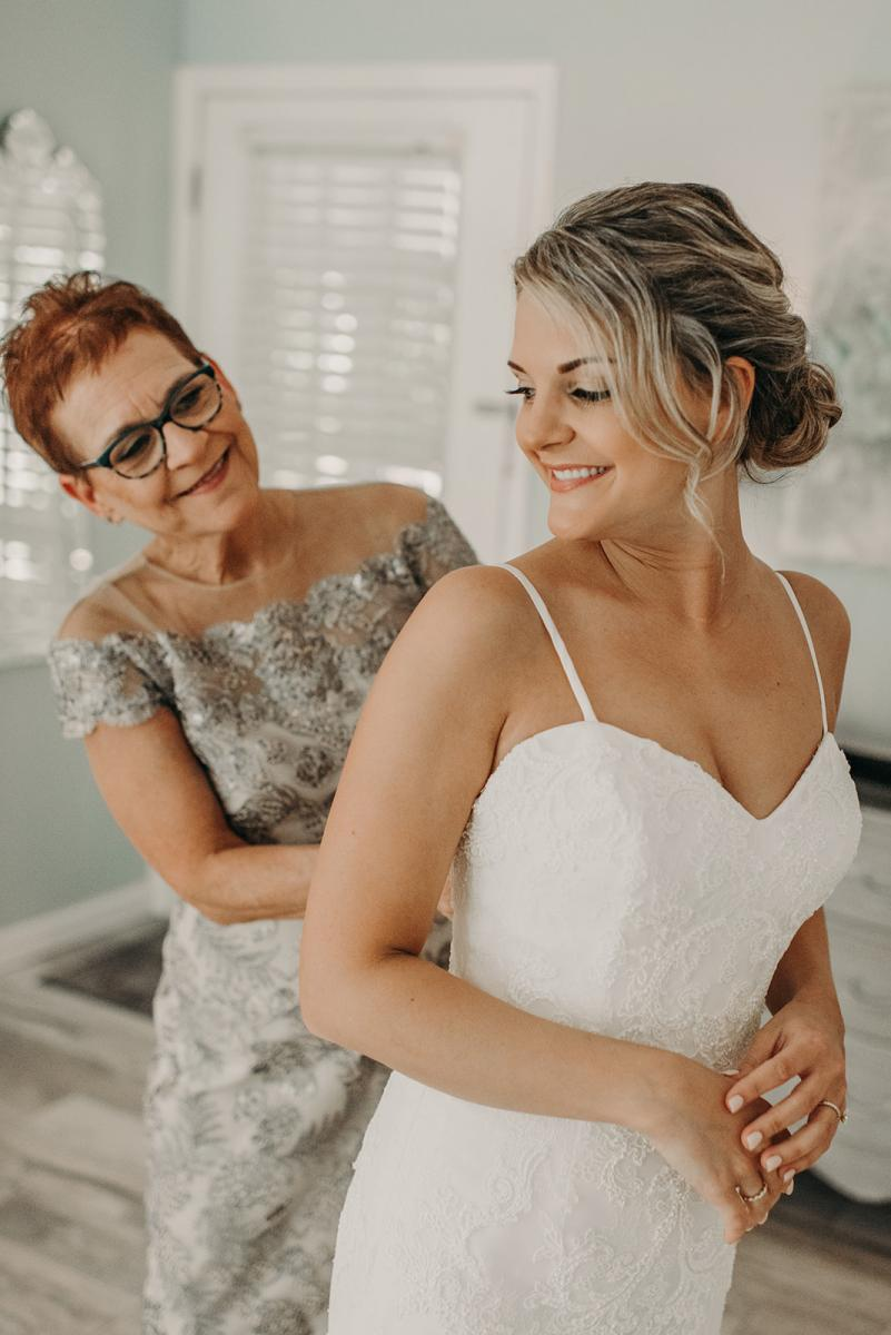 Linea's mother helping her with her dress