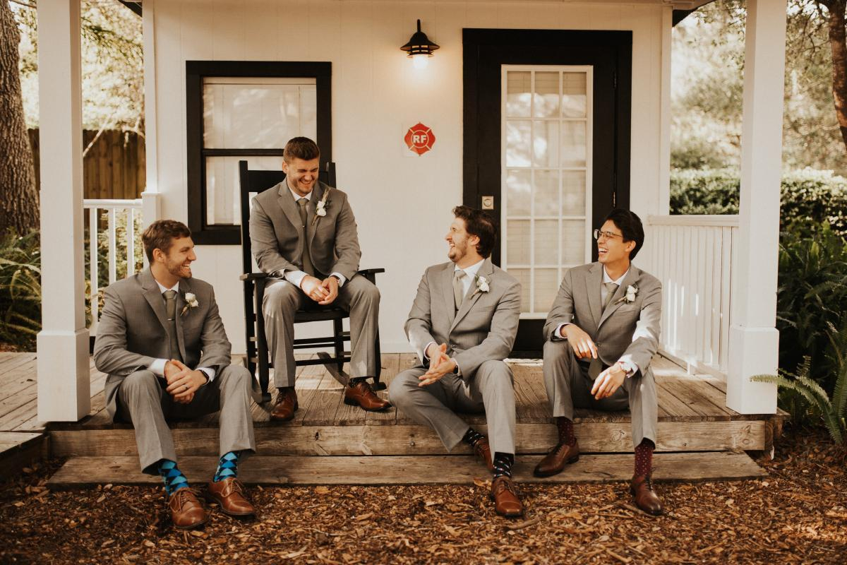 Connor and his groomsmen looking dapper in their gray suits