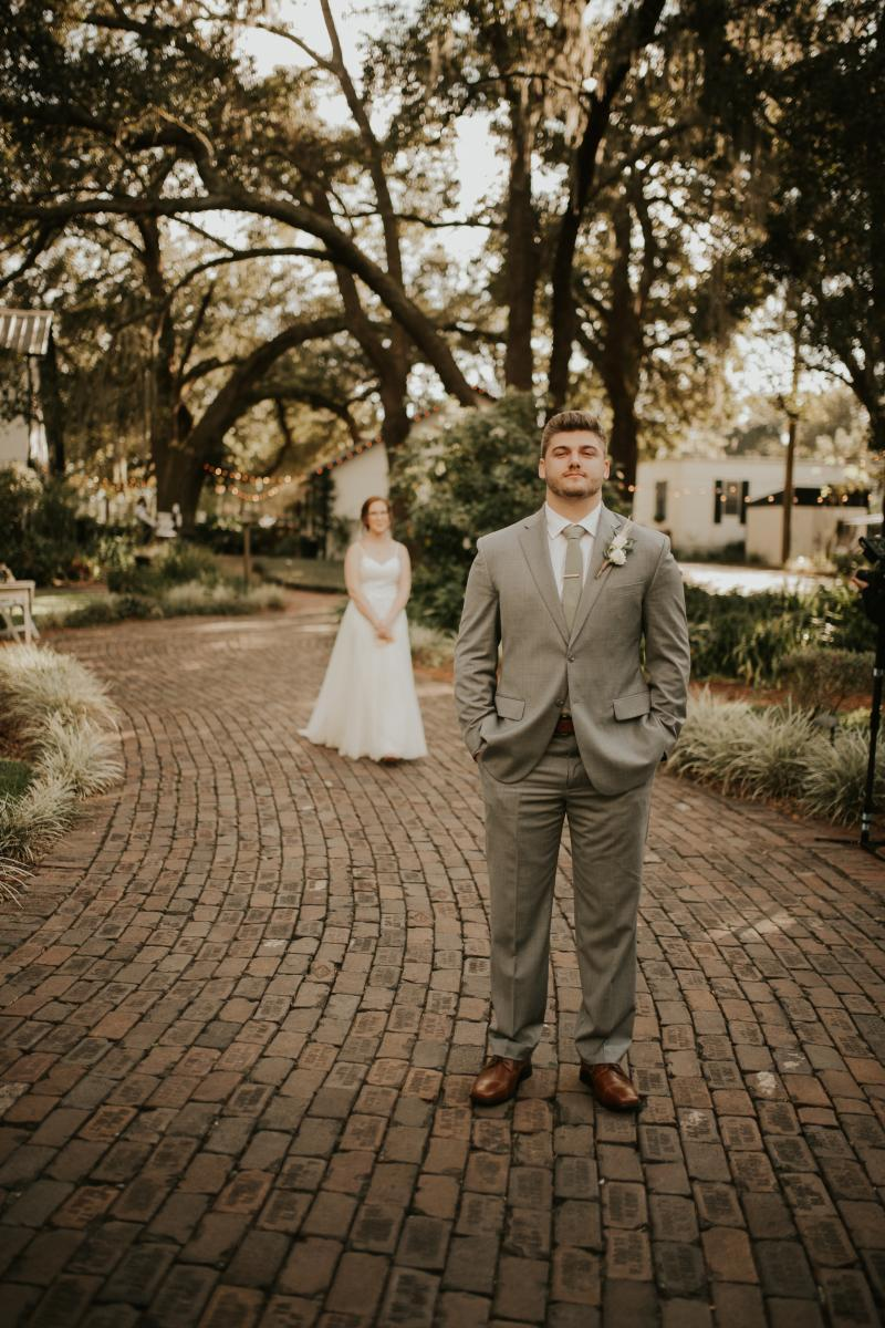 Wedding first looks on our iconic brick pathway