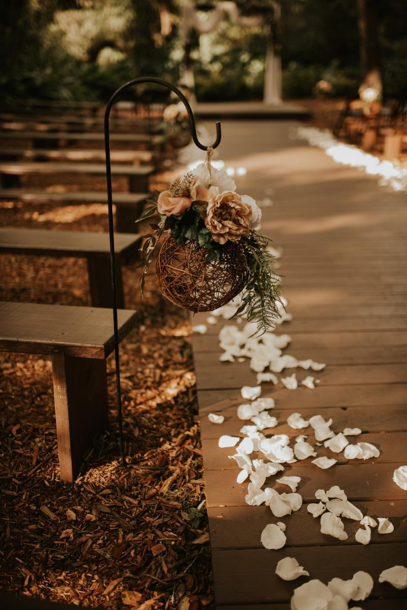Neutral boho wedding ceremony decor