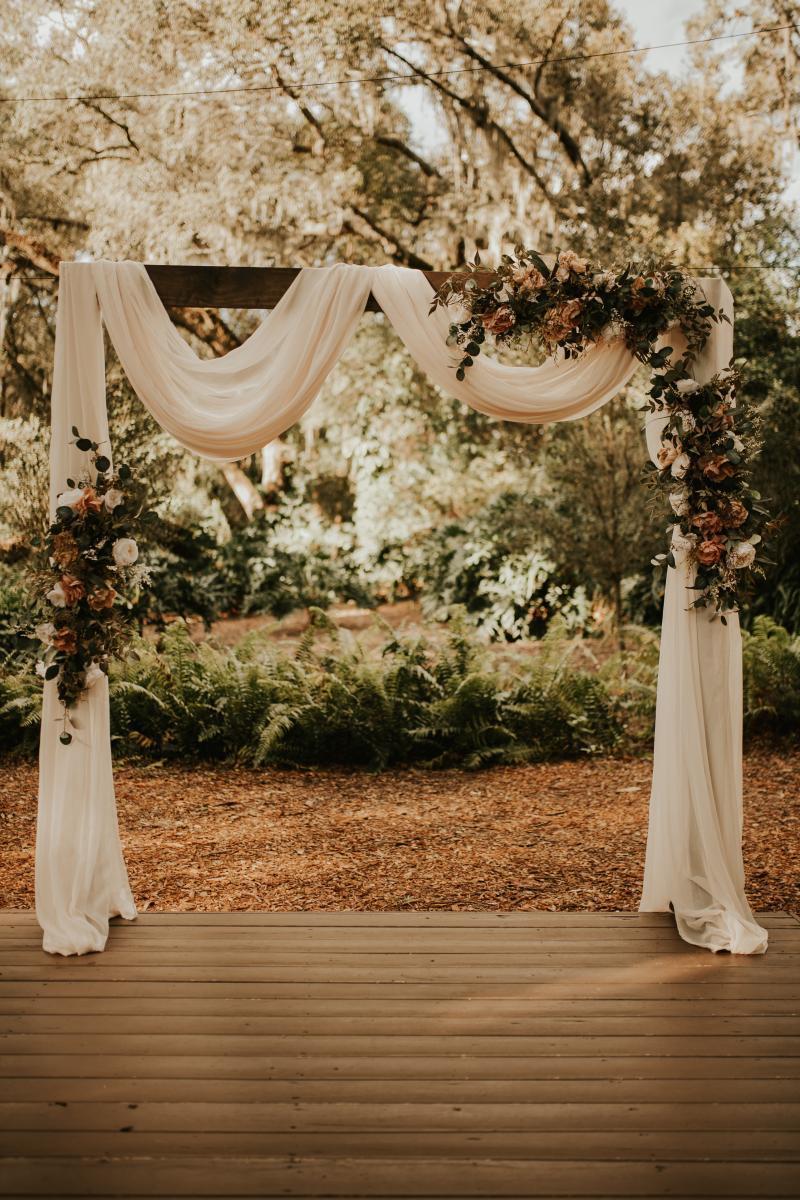 Autumn boho wedding ceremony decor