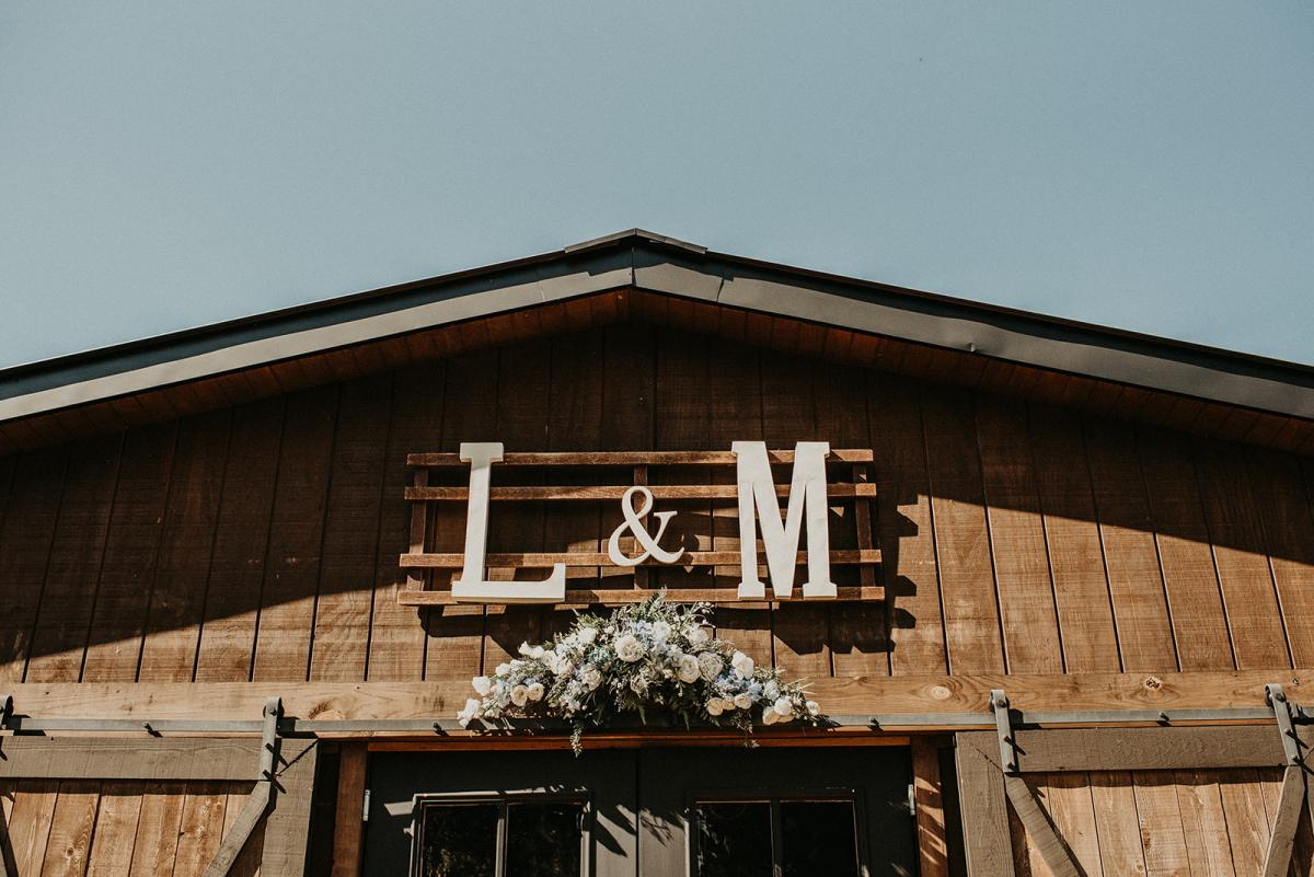 Mitch and Linea's initials on the front of the Carriage House Stable