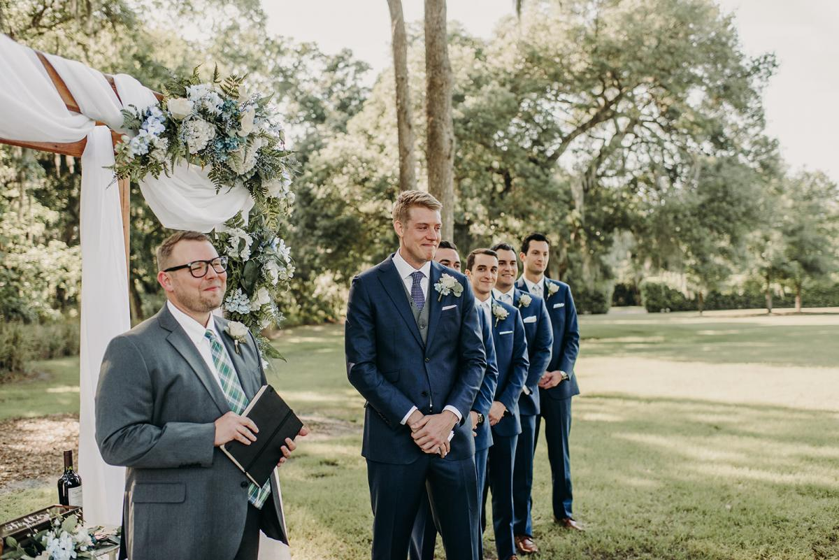 Mitch and his groomsmen watching Linea walk down the aisle