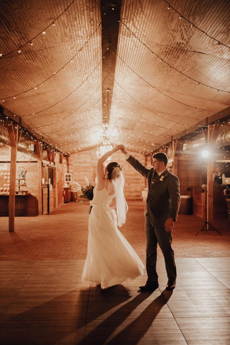 First dance inside a barn wedding venue