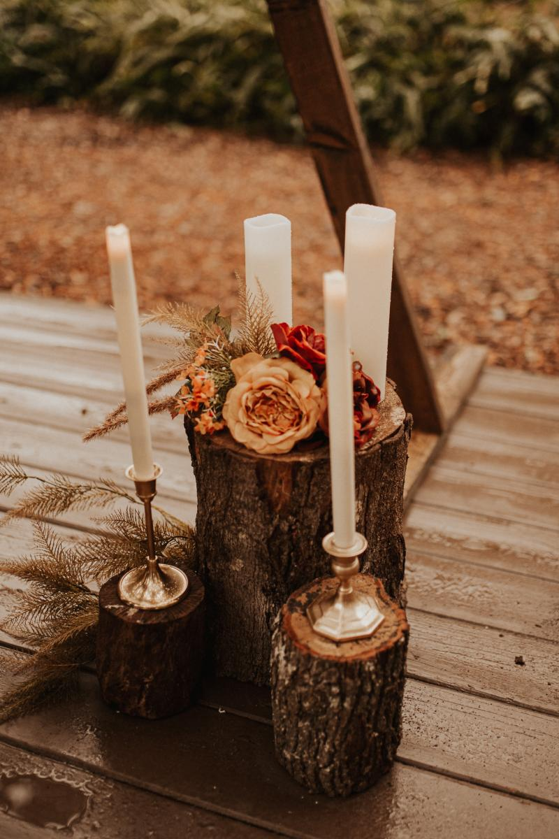 Rustic ceremony details with candles