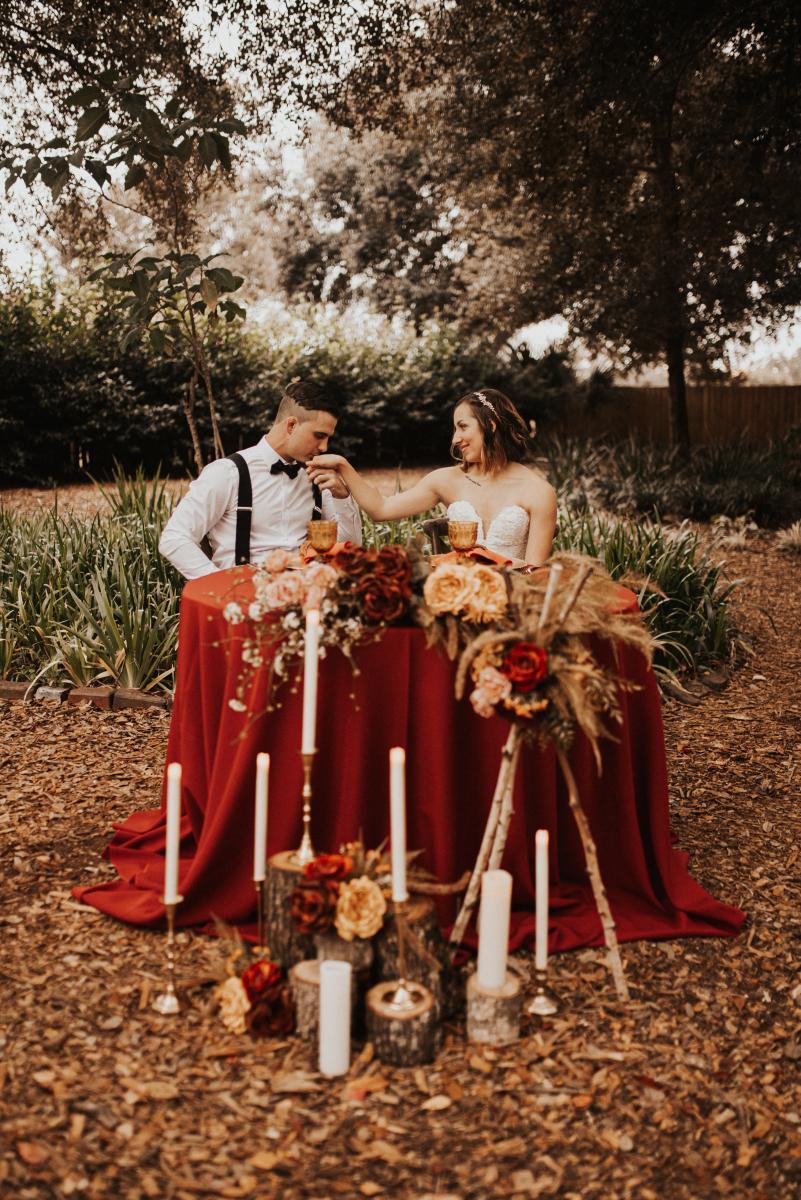 Boho wedding sweetheart table decor