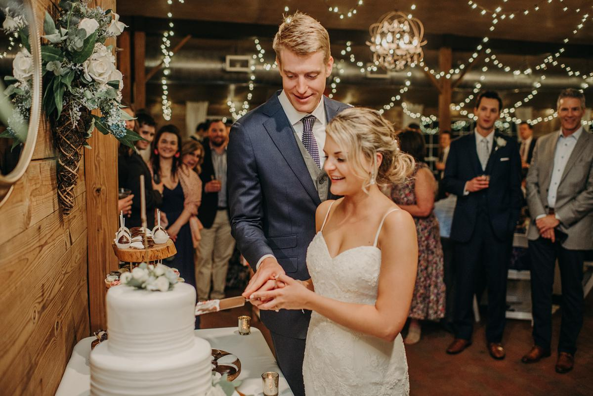 Mitch and Linea cutting their wedding cake
