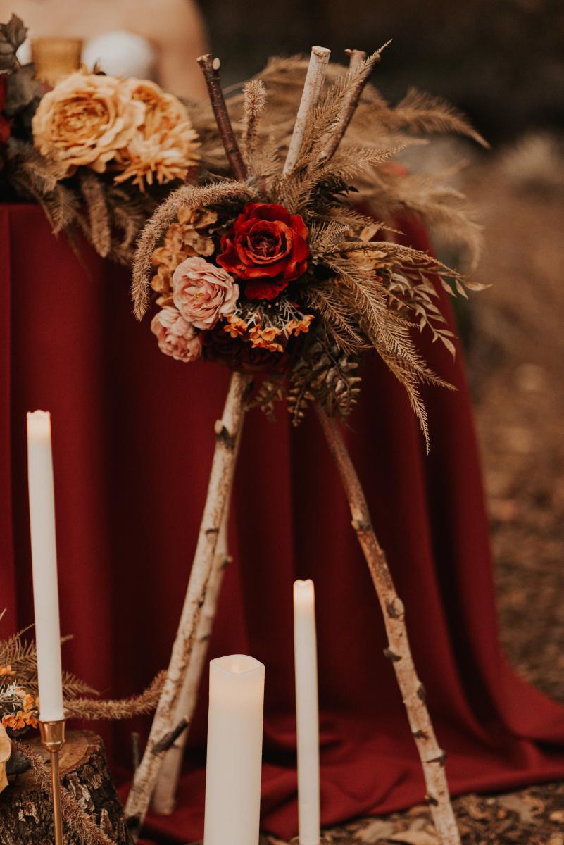 Wood teepee wedding decor