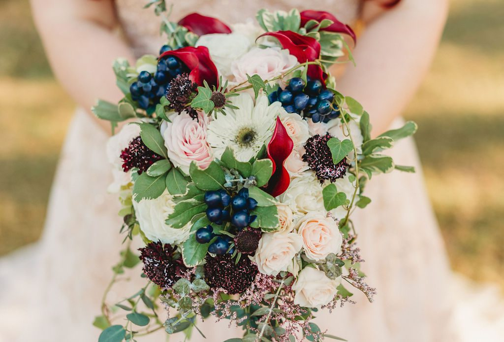 Heather's gorgeous fall bouquet filled with blush, red and blue floral