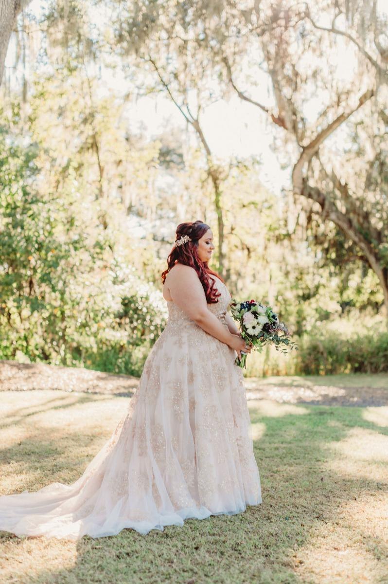 Heather looking stunning in her blush wedding dress with rose gold accents
