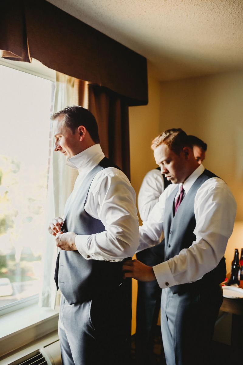 Jarrod's groomsmen helping him get ready