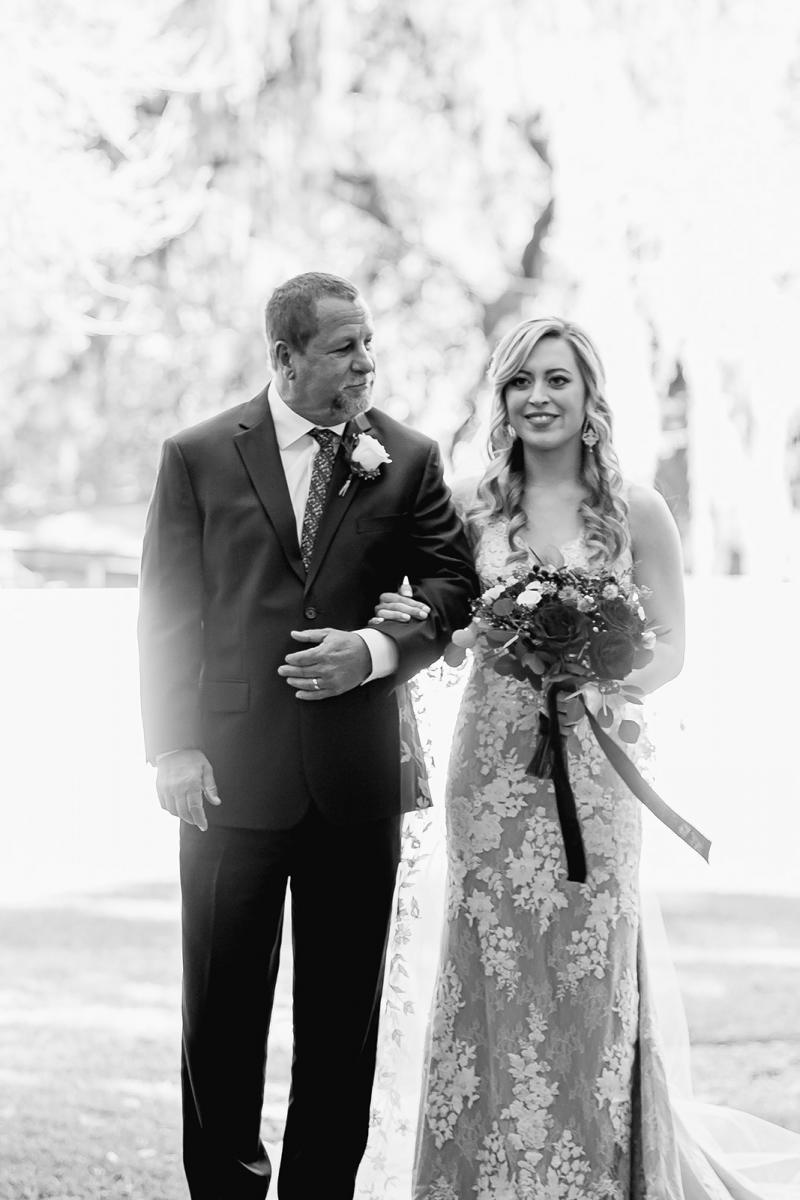 Brittany walking down the aisle with her father