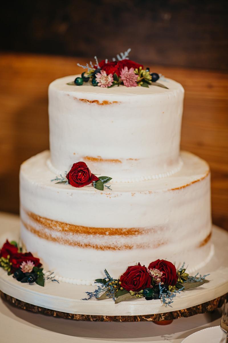 Enchanting wedding cake with pops of red