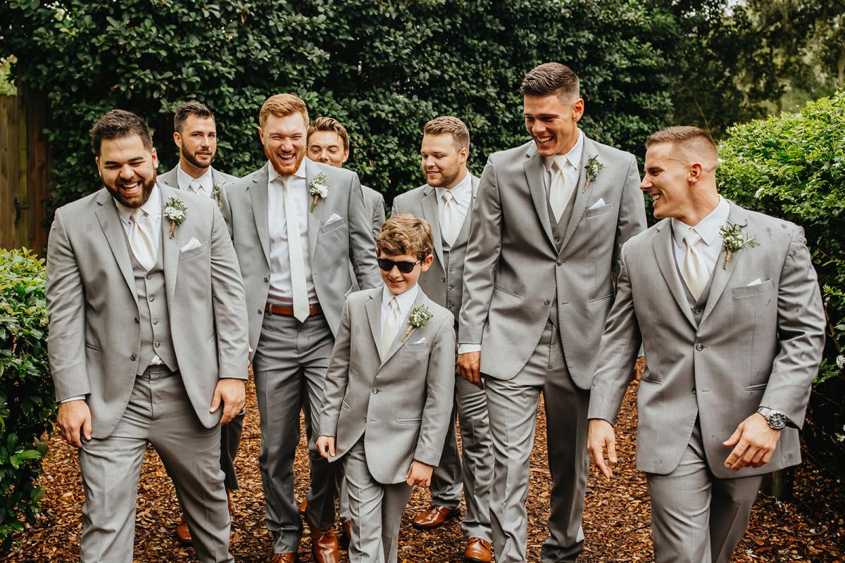 Nick's groomsmen were all dressed in gray suits