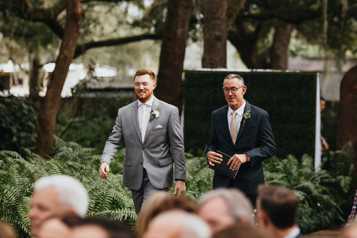 Nick walking down the aisle with their officiant