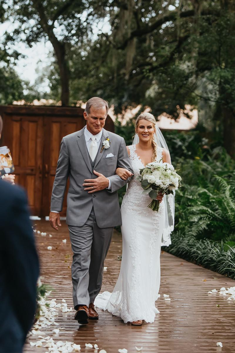 Bri walking down the aisle with her father