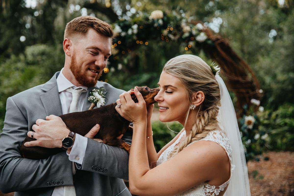 Their dachshund came for cute photos with the bride and groom