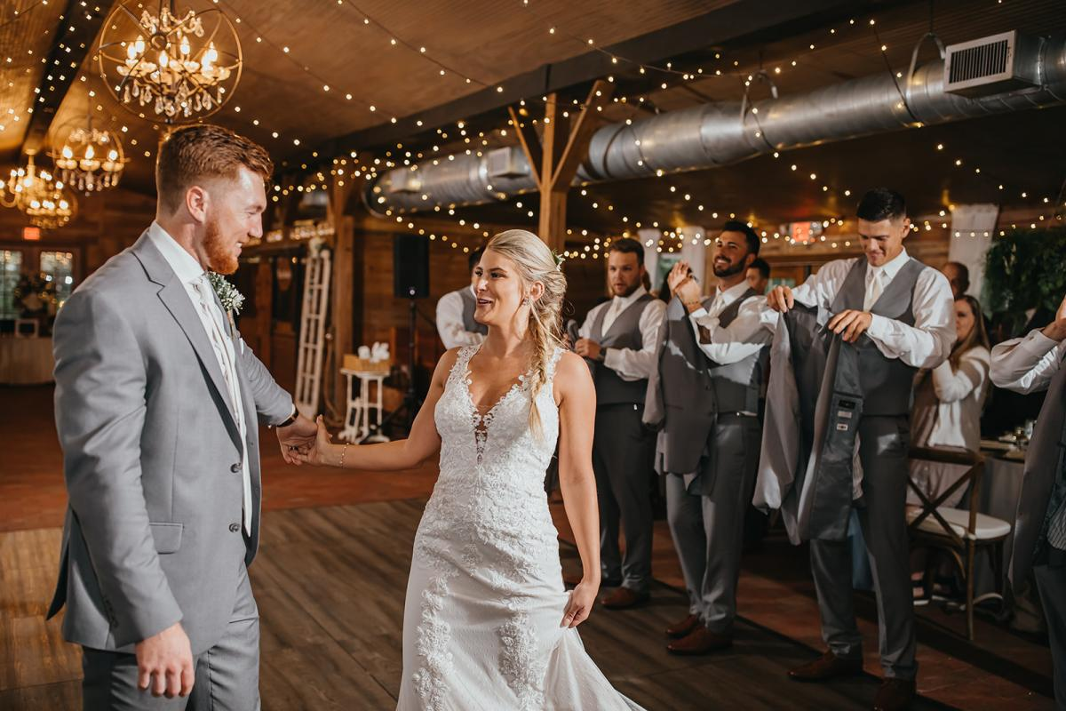 Walking into their wedding reception