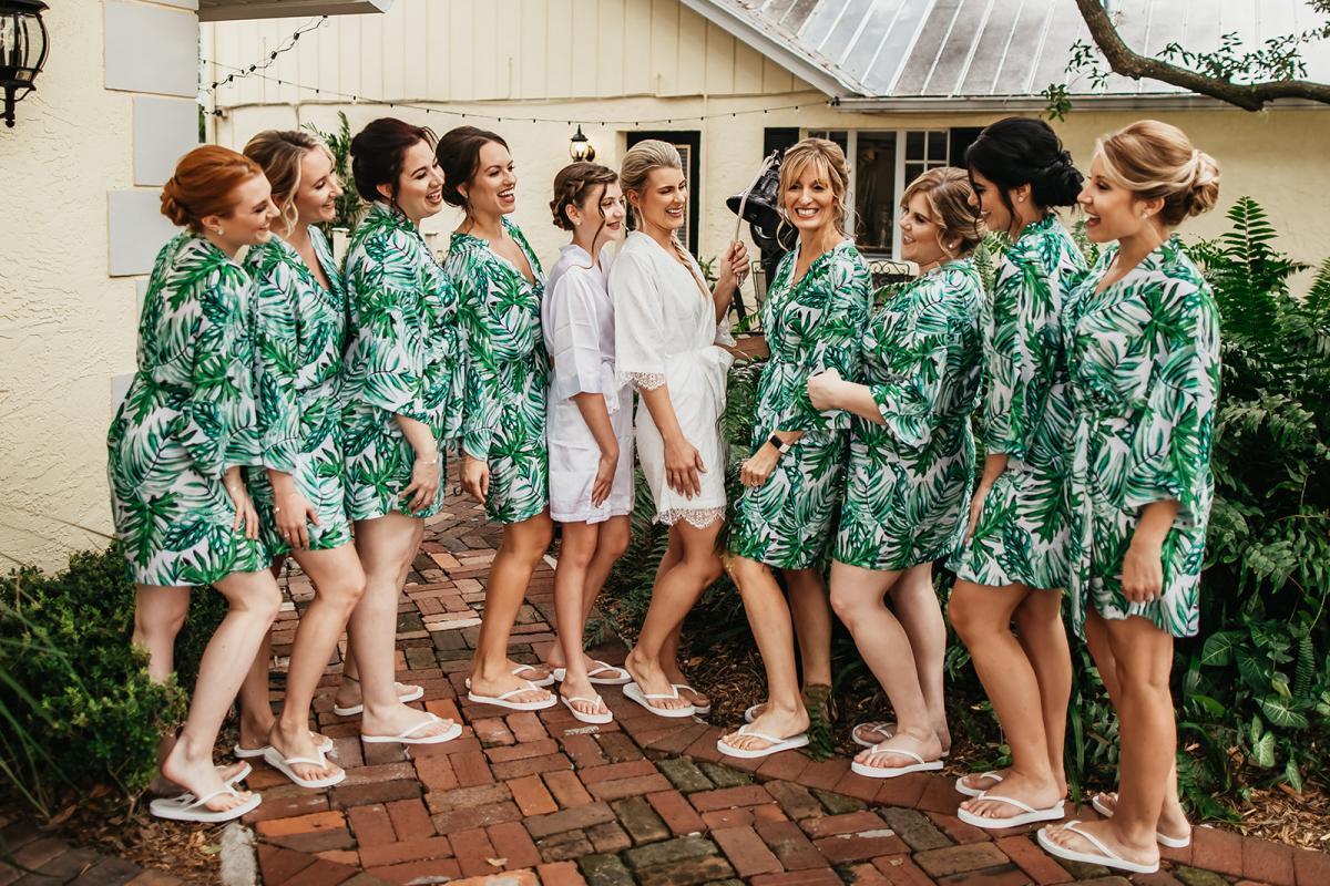 Bri's bridal party dressed in palm leaf robes