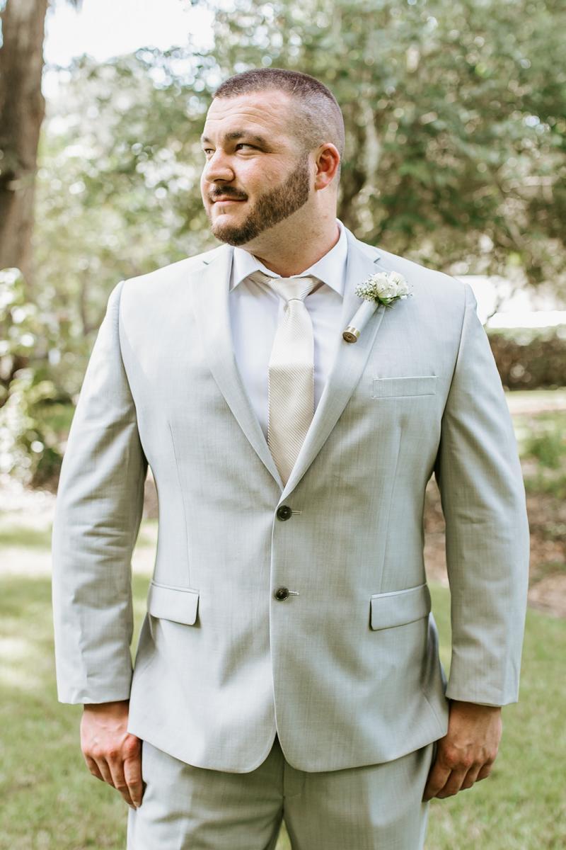 Sal dressed in his Calvin Klein light gray grooms suit