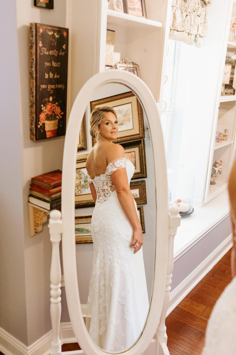 Ashley dressed in her Maggie Sottero wedding gown in the Main House