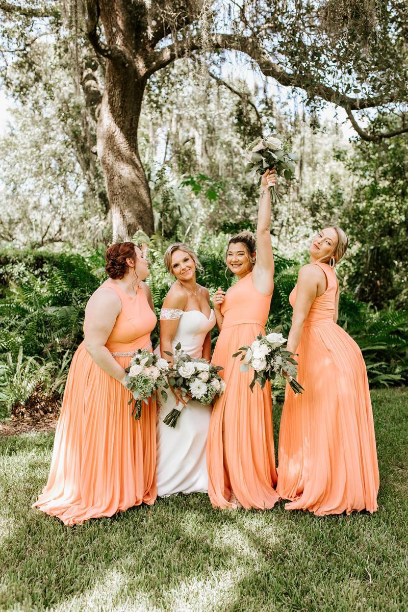 Ashley's ladies wore long chiffon peach bridesmaid dresses