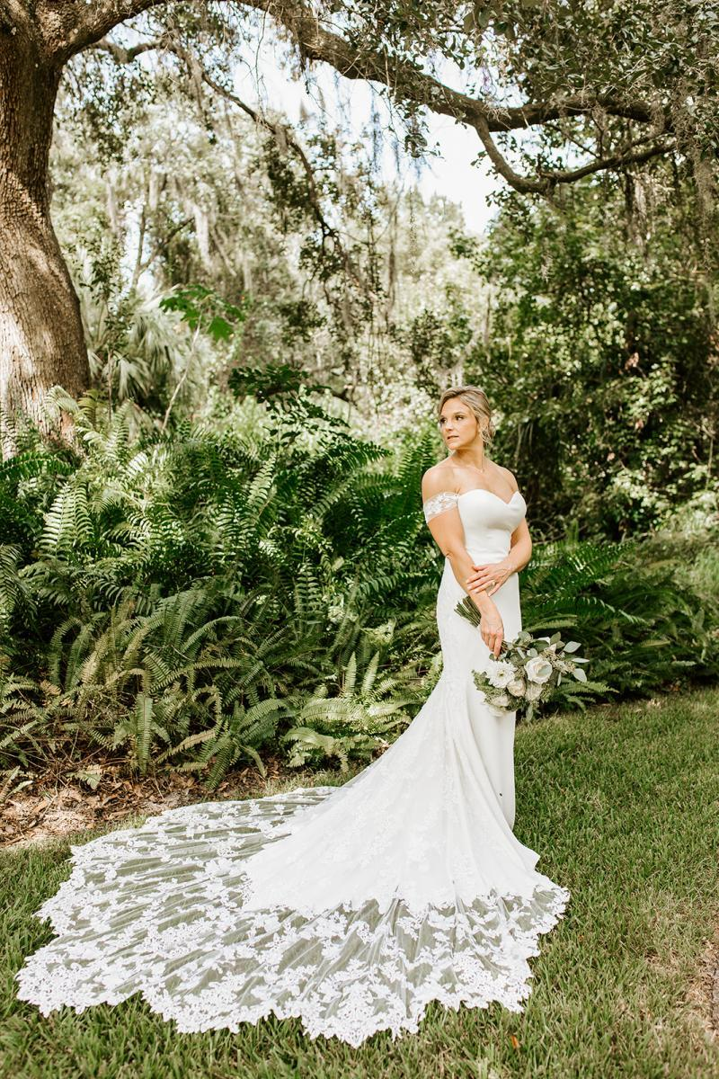 Maggie Sottero off-the-shoulder wedding gown with lace train