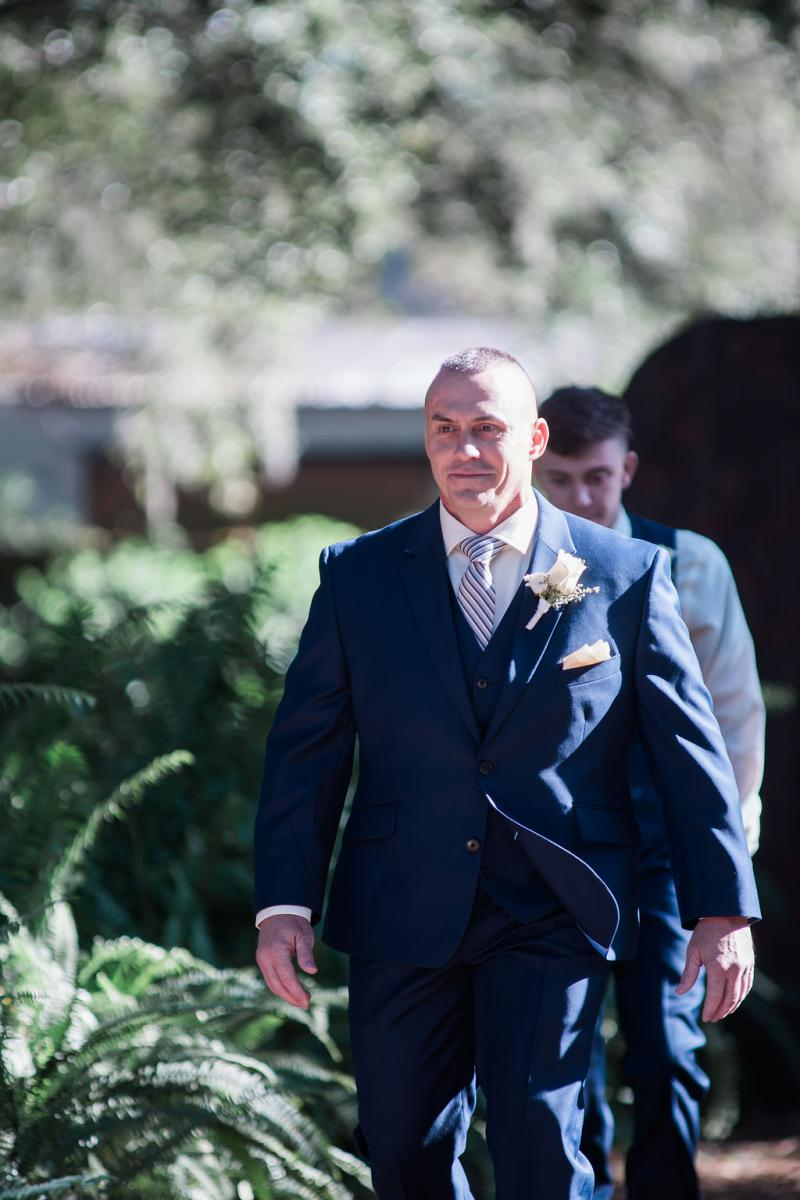 Dino walking down the aisle during the ceremony