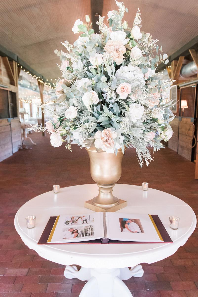 The large floral arrangment on Giselle and Dino's entrance table