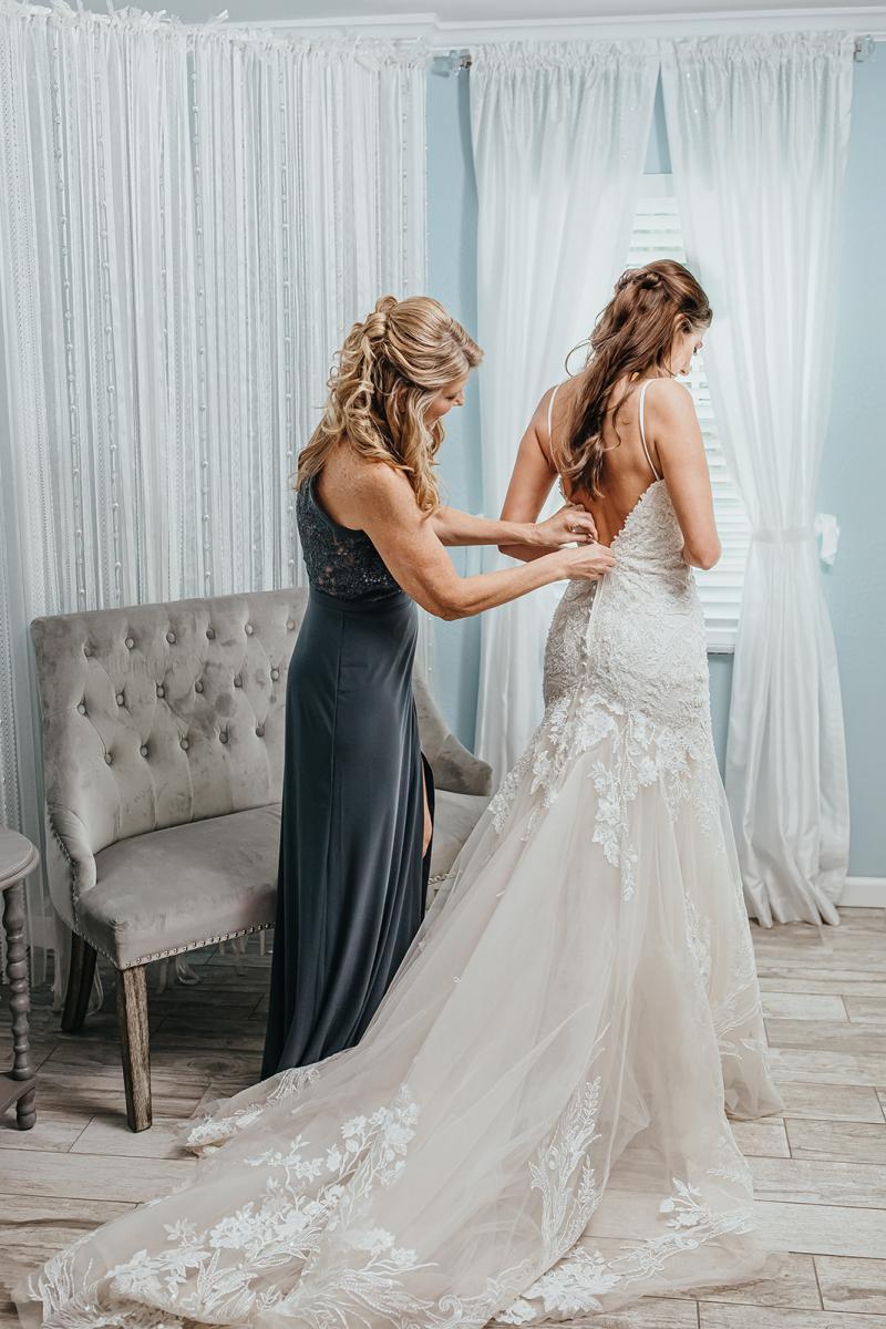 Rachel getting into her wedding gown