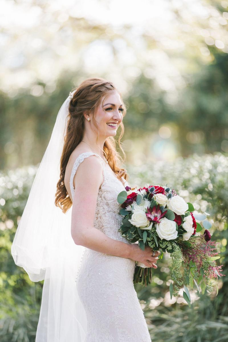 Haley looking beautiful in her white wedding dress, wedding veil and bouquet